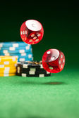 Rolling red dice — Stock Photo