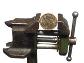 Coin one dollar is clamped in the old vice, isolated on a white — Stock Photo