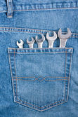 Blue jeans pocket with wrenches — Stock Photo