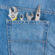 Several tools on a jeans pocket — Stock Photo