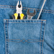 Several tools on a blue jeans pocket — Stock Photo