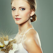 A beautiful sexual bride is in a wedding-dress, wedding decoration — Stock Photo
