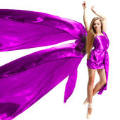 Beautiful girl, dancing in the blown about fabric on a light background — Stock Photo