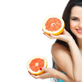 Girl in a turquoise swimming suit with a pink grapefruit, isolated on a white background, emotions — Stock Photo