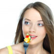 Portrait of a pretty young woman eating fruit salad isolated on a white background — Stock Photo #11537085