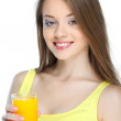 Portrait of a pretty young woman with glass of juice isolated on a white background — Stock Photo