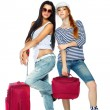 Two girl-friends, going to vacation . Isolated on a white background — Stock Photo
