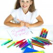 A beautiful girl in a school form drawing a marker, isolated on a white background — Stock Photo