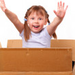 Little girl is happy moving to a new house — Stock Photo #10740898