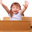 Little girl is happy moving to a new house — Stock Photo
