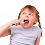 Pretty little girl brushes her teeth — Stock Photo
