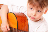Beautiful little girl plays guitar — Stock Photo