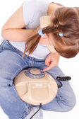 Little girl dials the number on the old phone — Stock Photo