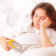 Pretty young woman lying in bed in the morning — Stock Photo