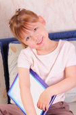 Beautiful little girl with book — 图库照片