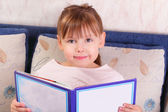 Pretty little girl sitting with book — Stok fotoğraf
