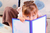 Pretty little girl with book — Stok fotoğraf