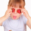 Funny little girl with tasty strawberries — Stock Photo #11290199
