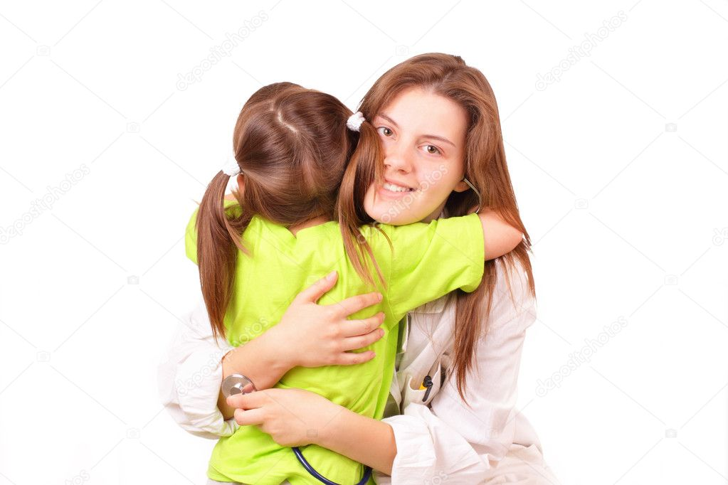 Young and pretty medical doctor woman with little girl — Stock Photo #11331130