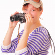 Beautiful young girl with binoculars in her hands — Stock Photo