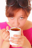Beautiful young girl drinking a cup of aromatic tea — Stock Photo