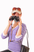 Pretty young girl with binoculars in her hands — Stock Photo