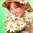 Funny young girl in the hat with chamomile flowers - Foto de Stock