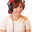 Funny young girl litening to music with headphones - Foto de Stock