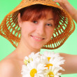 Happy young girl with chamomile flowers - Foto de Stock