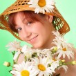 Pretty young girl in the hat with chamomile flowers — Stock Photo