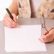 Young student woman writes — Stock Photo