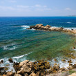 Mediterranean Sea coast near city of Paphos, Republic of Cyprus - Stock Photo