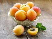 Group ripe juicy fruit apricot on a wooden table, rustic style — Stock Photo