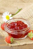 Strawberry jam and fresh berries on the table — Stock Photo