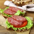 Royalty-Free Stock Photo: Sandwich with sausage salami, lettuce and tomato