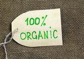 Ekologické označení na pozadí přírodní pytlovina — Stock fotografie