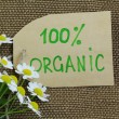 Organic label on the natural  burlap background — Stock Photo