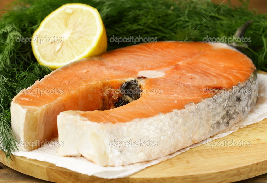 Red delicatessen  fish  salmon with lemon and dill — Stock Photo #11345873