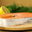 Red delicatessen fish salmon with lemon and dill — Stock Photo