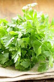Green, organic parsley on wooden table — Stock Photo