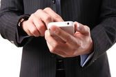 Businessman using a mobile phone on the white background — Stock Photo