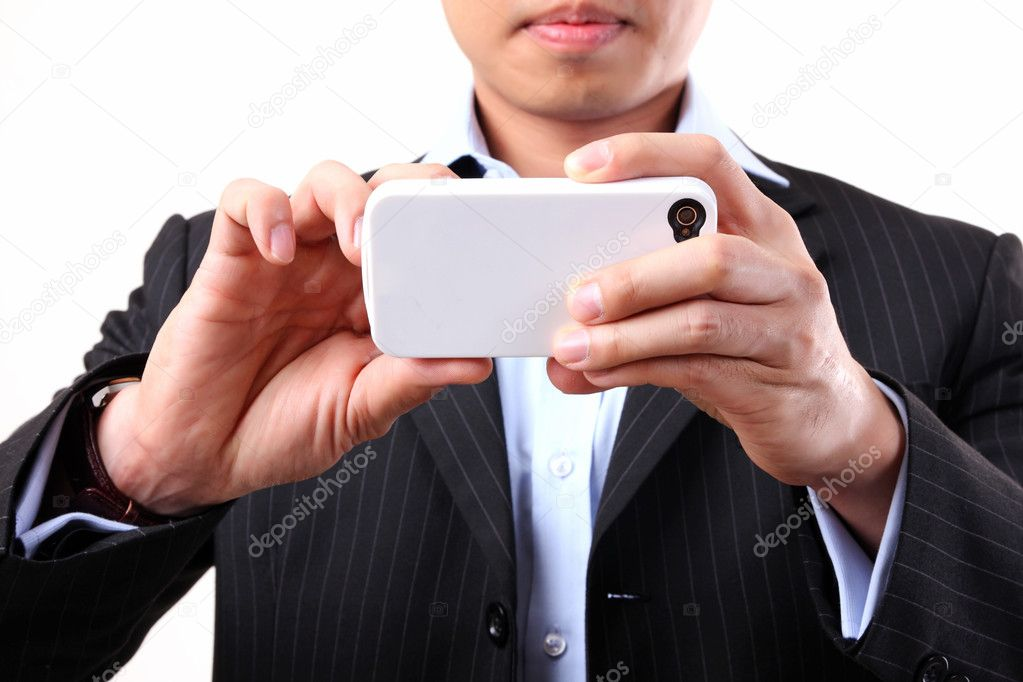 Asian businessman using a mobile camera on the white background — Stock Photo #10893058