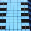 Stock Photo: Highrise glass building with reflection