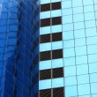 Highrise glass building with reflection — Stock Photo