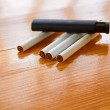 Cigarettes and lighter on wooden table — Stock Photo