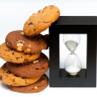 Cookie stack next to egg timer — Stock Photo
