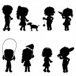 Children silhouettes active — Stock Vector