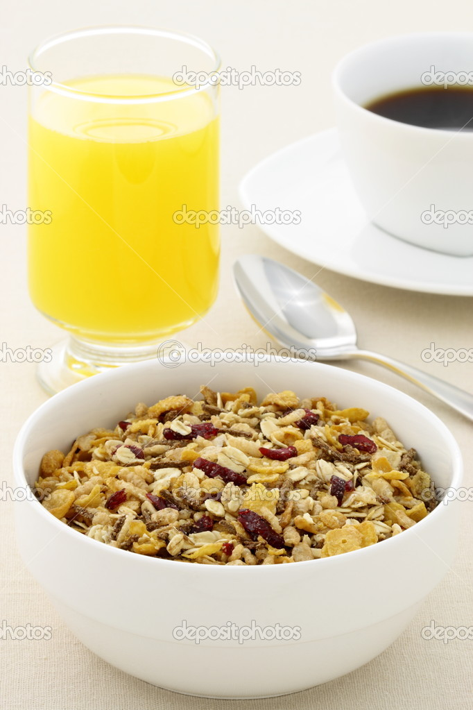Delicious breakfast with fresh orange juice, hot coffee and a healthy bowl of cereal. — Stock Photo #11472472