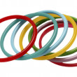 Stock Photo: Multicolor plastic bangles arranged on white background