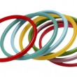 Multicolor plastic bangles arranged on white background - Stock Photo